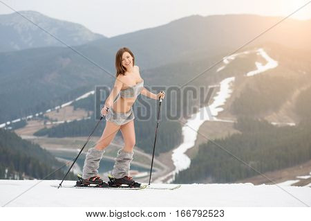 Sexy Beautiful Naked Woman Skier Posing On The Snowy Slope Of The Mountain With Ski Equipment. Looki