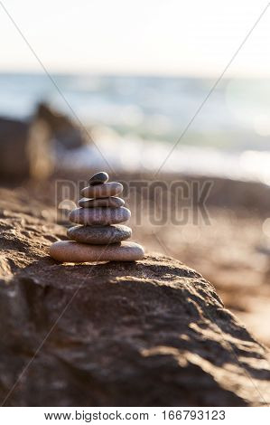 Figure of pebbles on sea coast in summer in afternoon