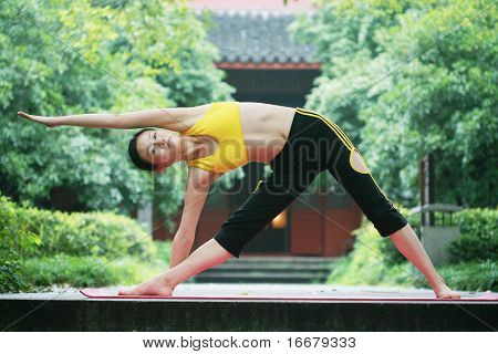 young chinese women doing yoga outside