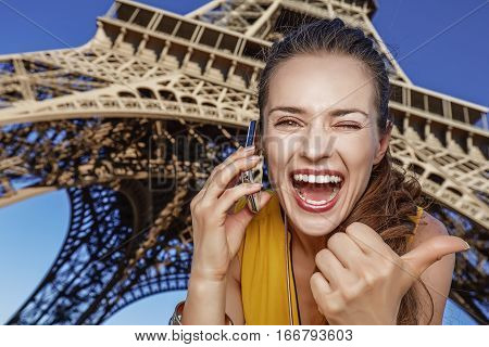 Woman Showing Thumbs Up And Speaking On Mobile Phone In Paris