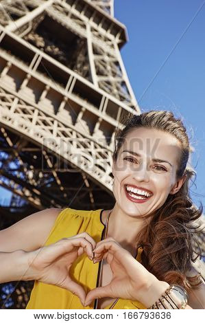 Woman Showing Heart Shaped Hands In Front Of Eiffel Tower, Paris