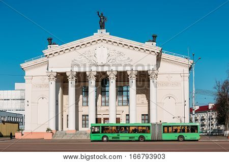 City Bus Moving Along Street Near Building Of Gomel Regional Drama Theatre On The Lenin Square In Gomel, Belarus. poster