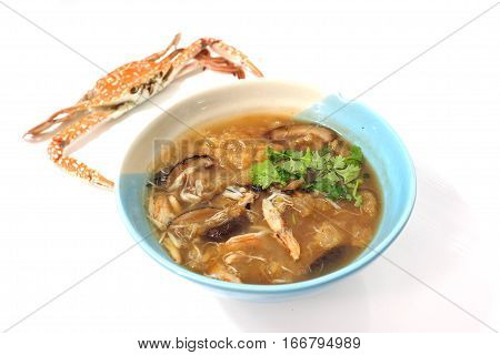 Braised fish maw in red gravy abalone mushroom with crab meat The presentation is white background and steamed crab out focus.