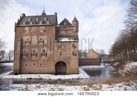 castle doorwerth and moat in Holland on winter day in the province of Gelderland
