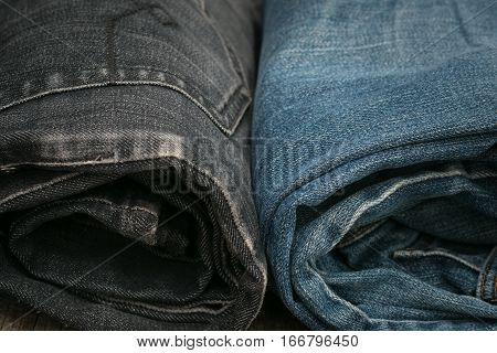 Blue jeans rolled and  back pocket in fron of Background.