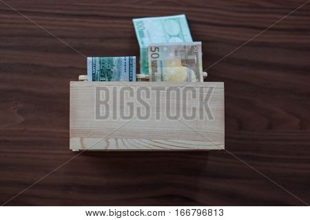 Paper Money sticking out of a half-open drawer