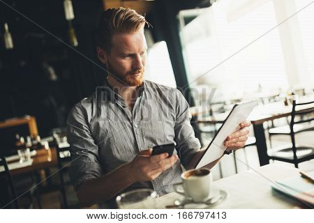 Businessman constantly busy and working in a cafe