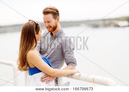 Couple enjoying time spent together and smiling outdoors