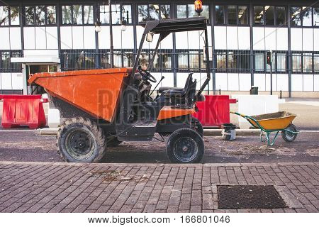 Road tractor with working tools inside to clean the roads