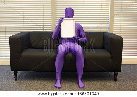 messenger  - man  with blank whiteboard  -  sitting on sofa in office