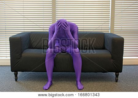 thinking man solving problem sitting on sofa