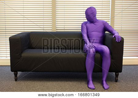 loneliness - one man sitting on sofa