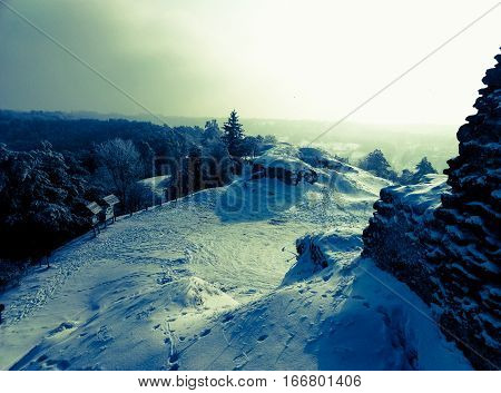 the extraordinary beauty of the winter landscape on top of a hill blue