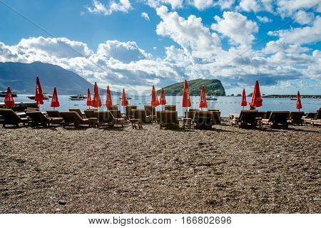 BUDVA, MONTENEGRO - SEPTEMBER 19, 2016:Sun loungers and umbrellas are on the beach in Budva, Montenegro.