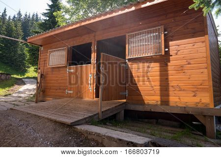 Perspective view of empty horse stable on the farm