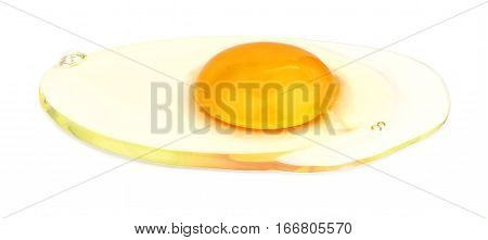 Fresh raw egg with orange yolk without the shell, isolated on a white background.