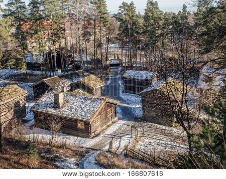 Bygdoy Norway - February 23 2016: Wooden houses inside the open air folk museum in Oslo