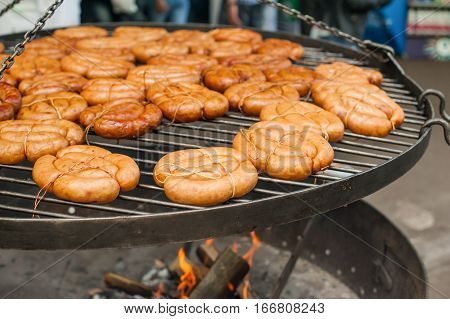 Grilled Sausage On The Flaming Grill On The Street Food Market