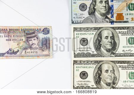 Close up view of US Dollar and Brunei Dollar indicating strong currency exchange rate