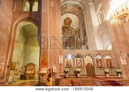 MTSKHETA, GEORGIA - OCT 13, 2016: Interior and old frescoes of the christian Svetitskhoveli Cathedral on October 13, 2016. Cathedral was built in 4th century. UNESCO World Heritage Site.