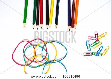 paper clip color pencil and elastic on white paper