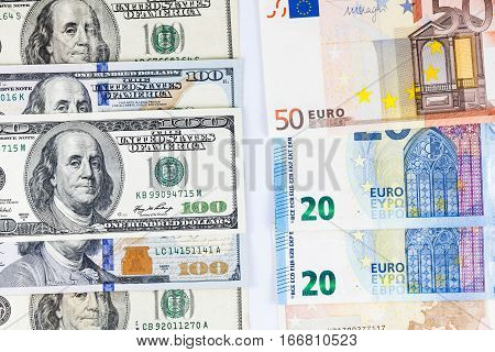 Close up view of US Dollar and Europe Euro indicating strong currency exchange rate