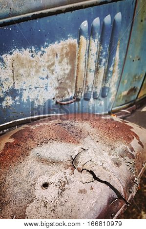 Color Toned An Old Cracked Rusty Car Fender.