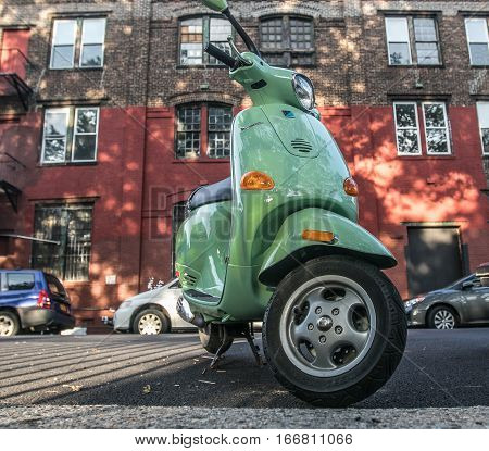 Brooklyn, New York, September 17, 2016: A Vespa scooter is parked in the street.