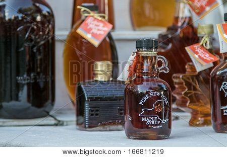New York, June 29, 2016: Maple syrup poured in glass bottles is for sale on a farmer's market at Union Square.