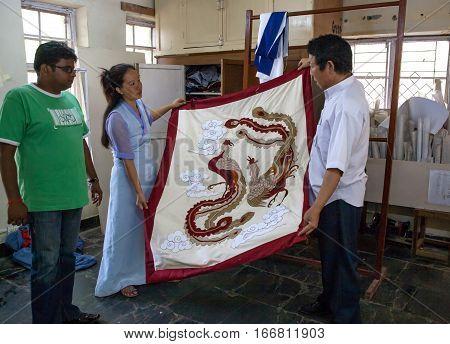 DHARAMSALA, INDIA. 2 June 2009: The Norbulingka Institute. Craftsmen show a beautiful traditional Tibetan embroidery. Western Himalaya, Himachal Pradesh, district of Kangra.