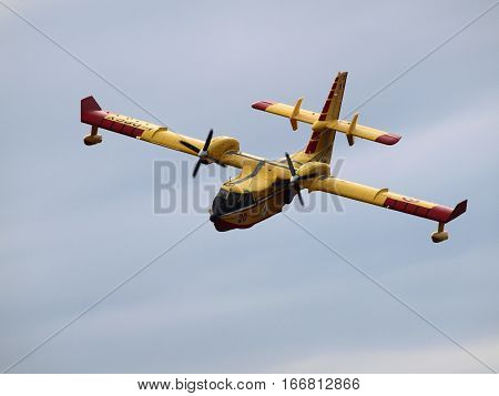 The photo was taken at Air Show 2010 (Ferrara, Italy) and shows a plane of the Italian public safety in action.