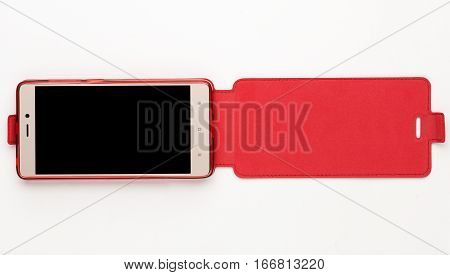 Smartphone in red leather cover cot, isolated on white background