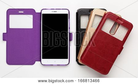 Set of color leather cases with a window for the smartphone on a white background