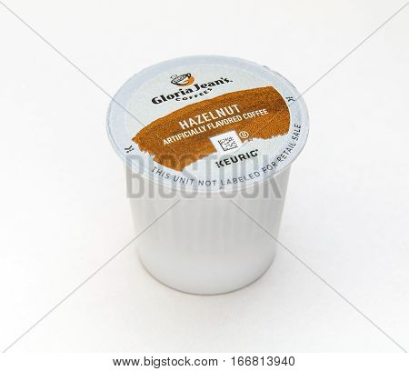 New York, January 5, 2017: A single hazelnut flavored coffee capsule for Keurig coffee machine by Gloria Jean's is seen against white background.