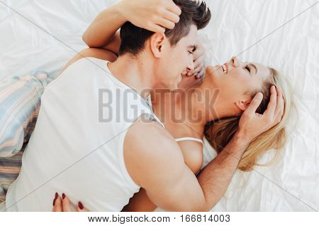 Happy Couple In Bedroom