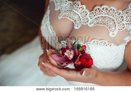 gorgeous fiancee with beautiful breast holding bride boutonniere