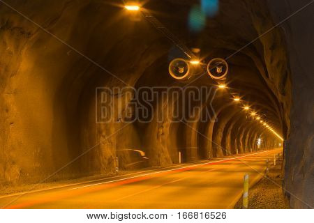 Tunnel with traffic lights and light trails of car traffic. This underground passageway connects Faskrudsfjordur and Reydarfjordur in East Iceland.