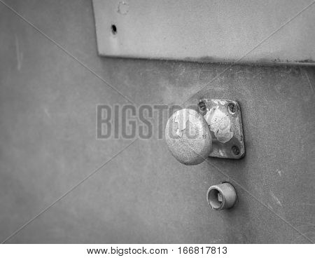 Weathered abstract doorknob in black and white