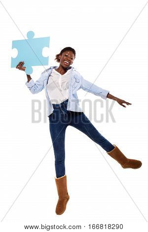 Afro American  Women Jumping With Puzzle Pieces
