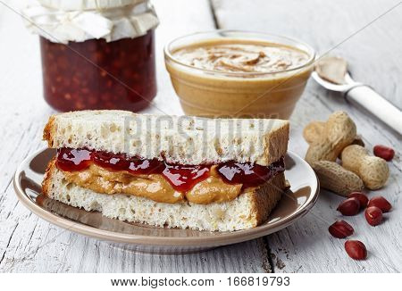 Plate of peanut butter and strawberry jelly sandwich