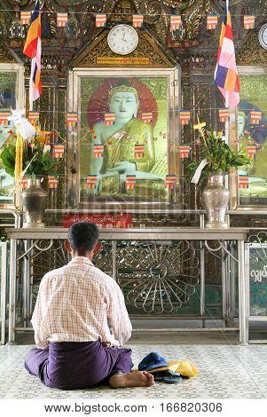 Yangon Myanmar - 9 January 2010: Man praying at the Sule Paya Pagoda in Yangon on Myanmar