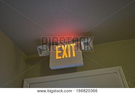 Neon Exit sign above Hotel Door and Doorway