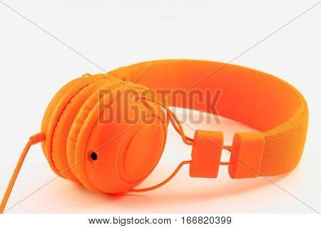 Big orange headphones on a light background
