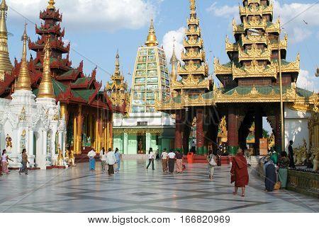 Yangon Myanmar - 9 January 2010: People walking in the area of the Shwedagon Pagoda in Yangon on Myanmar