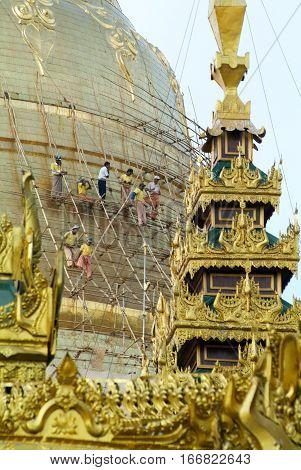 Yangon Myanmar - 9 January 2010: Workers repairing the stupa of the Shwedagon Pagoda in Yangon on Myanmar