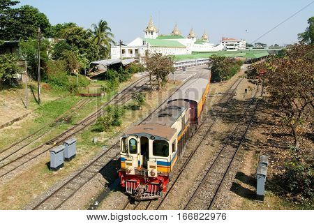 YANGON MYANMAR - 9 Januray 2010 - A Circular Railway Train leaves Yangon Central Railway Station in Yangon (Rangoon) on Myanmar. Yangon Circular Railway is the local commuter rail network.