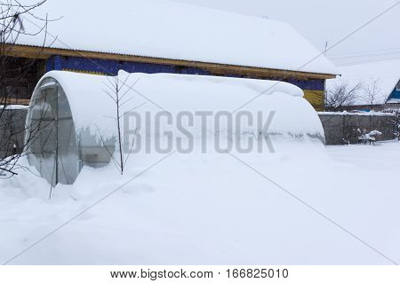 large glass greenhouse inscribed layer of snow
