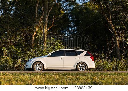 DNIPROPETROVSK REGION, UKRAINE - AUGUST 26 2015: KIA CEED ON THE ROAD NEAR THE FOREST