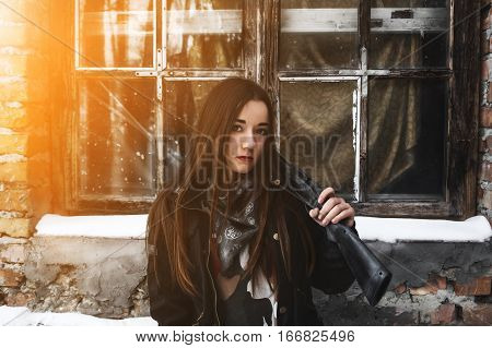 Portrait of brunette girl with a gun. Police undercover