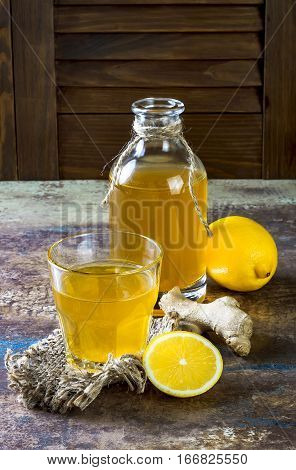 Homemade fermented raw ginger lemon kombucha tea. Healthy natural probiotic flavored drink. Copy space